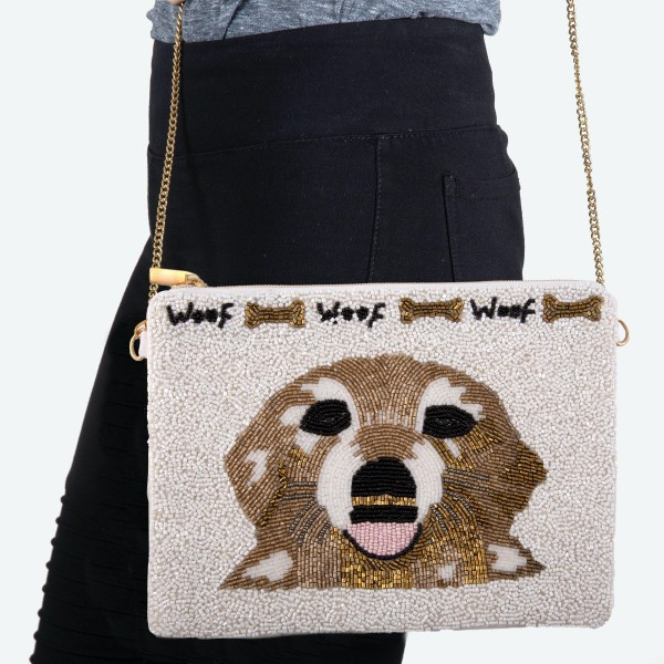 """White Seed Beaded Canvas Crossbody Handbag Featuring Dog Face Print.  - Zipper Closure - One Inside Pocket - Spot Clean Only - Chain Link Strap 21"""" L - Approximately 9"""" W x 7"""" T - 100% Polyester"""
