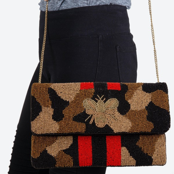 """Designer Inspired Camouflage BEE Stripe Seed Beaded Canvas Crossbody Clutch.  - Fold Over Flap Button Closure - One Inside Pocket - Spot Clean Only  - Chain Link Strap 21"""" L  - Approximately 10"""" W x 6"""" T - 100% Cotton"""