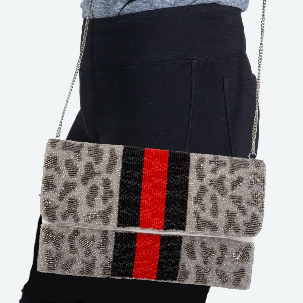 """Designer Inspired Leopard Stripe Seed Beaded Canvas Crossbody Clutch.  - Fold Over Flap Button Closure - One Inside Pocket - Spot Clean Only - Chain Link Strap 21"""" L - Approximately 10"""" W x 6"""" T - 100% Cotton"""
