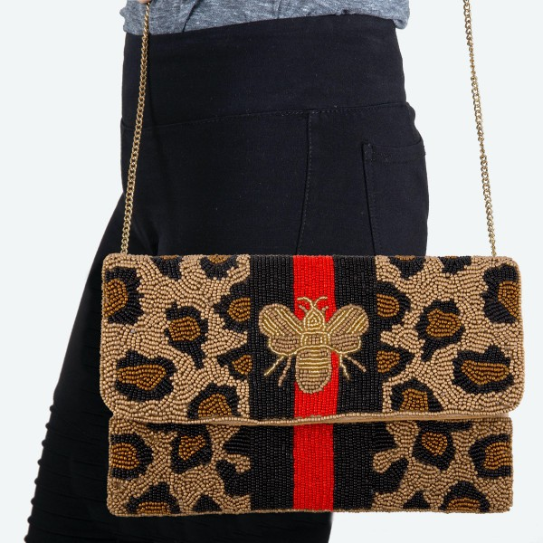 """Designer Inspired Leopard BEE Stripe Seed Beaded Canvas Crossbody Clutch.  - Fold Over Flap Button Closure - One Inside Pocket - Spot Clean Only  - Chain Link Strap 21"""" L  - Approximately 10"""" W x 6"""" T - 100% Cotton"""