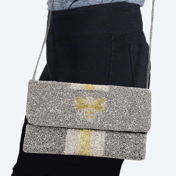 """Designer Inspired Hematite BEE Stripe Seed Beaded Canvas Crossbody Clutch.  - Fold Over Flap Button Closure - One Inside Pocket - Spot Clean Only  - Chain Link Strap 21"""" L  - Approximately 10"""" W x 6"""" T - 100% Cotton"""