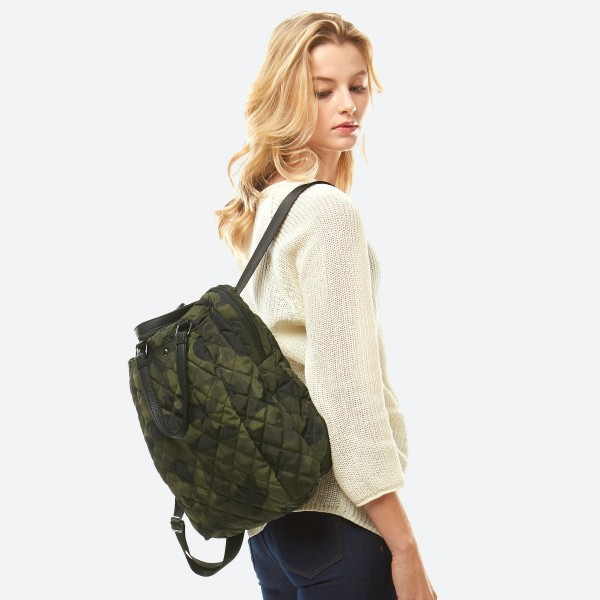 "Puffy Quilted Camouflage Shoulder Backpack.  - Zipper Closure - Open Lined Inside - Inside Zipper Pocket - Outside Magnetic Button Pocket - Outside Zipper Back Pocket - Short PU Handles to Carry - Adjustable Backpack Straps - 90% Polyester / 10% PU - Approximately 14"" T x 12"" W"