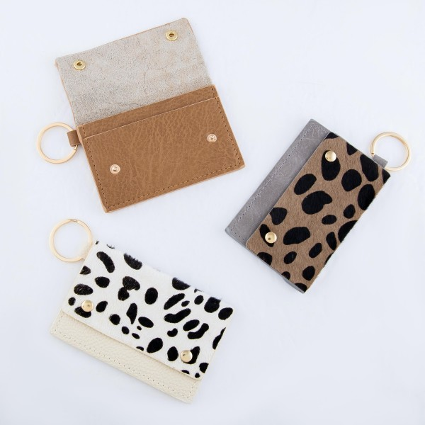 """Genuine Leather Cow Print CC/ID Keychain Holder.  - Faux Leather  - Button Closure - 2 CC/ID Pockets - Keyring to attach Keys - Approximately 4"""" x 2.75"""""""