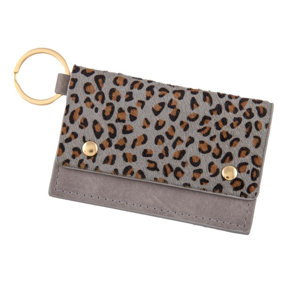 """Genuine Leather Leopard Print CC/ID Keychain Holder.  - Faux Leather  - Button Closure - 2 CC/ID Pockets - Keyring to attach Keys - Approximately 4"""" x 2.75"""""""