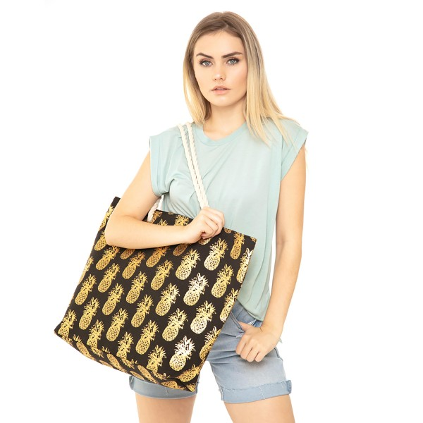 "Metallic Pineapple Print Canvas Tote Bag.  - Button Closure - Lined Inside - One Inside Open Pocket - 12"" Rope Handles - Approximately 20"" x 14""  - 60% Cotton / Polyester"