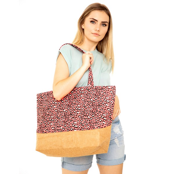"Leopard Print Canvas Tote Bag.  - Top Zipper Closure - Open Lined Inside - 1 Inside Open Pocket - 12"" Handles - Approximately 19"" x 14""  - 65% Polyester / 35% Cotton"