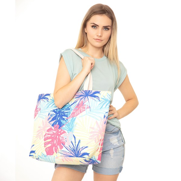 "Multicolor Palm Leaf Print Canvas Tote Bag.  - Button Closure - Lined Inside - One Inside Open Pocket - 11"" Handles - Approximately 20"" x 14""  - 60% Cotton / 40% Polyester"