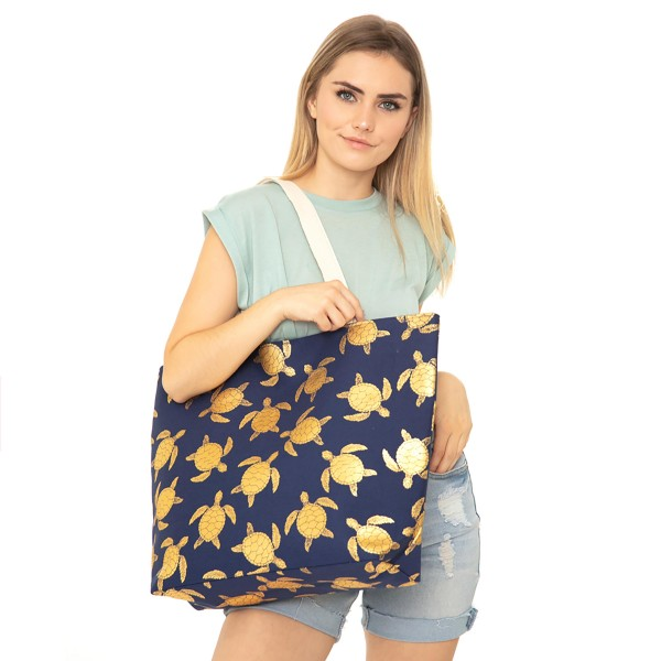 "Metallic Sea-turtle Print Canvas Tote Bag.  - Button Closure - Lined Inside - One Inside Open Pocket - 11"" Handles - Approximately 20"" x 14""  - 60% Cotton / 40% Polyester"