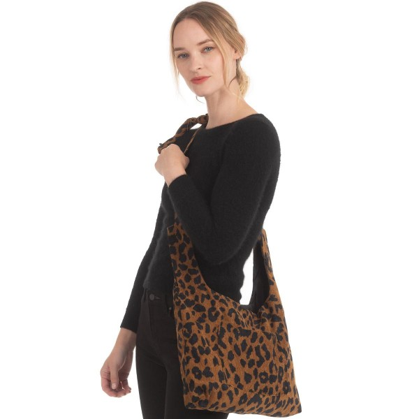 "Corduroy Leopard Print Drawstring Handbag.  - Drawstring Closure - Open Lined Inside - 1 Inside Open Pocket - 1 Outside Open Pocket - Tie Detail Shoulder Strap - Approximately 16"" x 11"""