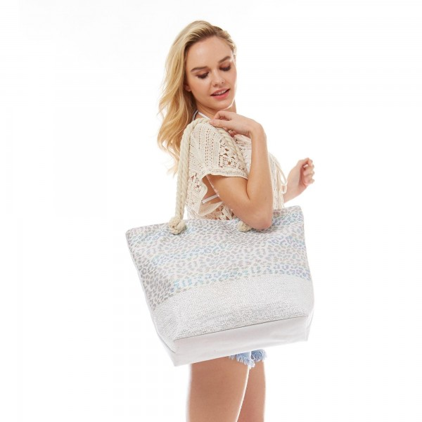 "Iridescent Leopard Print Canvas Tote Bag.  - Zipper Closure - Open Lined Inside - 1 Open Inside Pocket - Rope Handles - Approximately 19"" x 14""  - 70% Cotton, 30% PU"