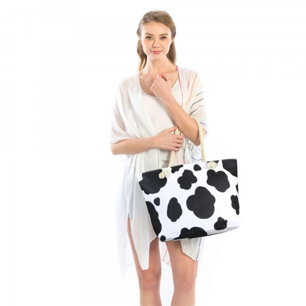 """Cow Print Tote Bag with Rope Handles.  - Zipper Closure - Open Lined Inside - 1 Inside Open Pocket - 12"""" Rope Handles - Approximately 21"""" x 14""""  - 100% Polyester"""