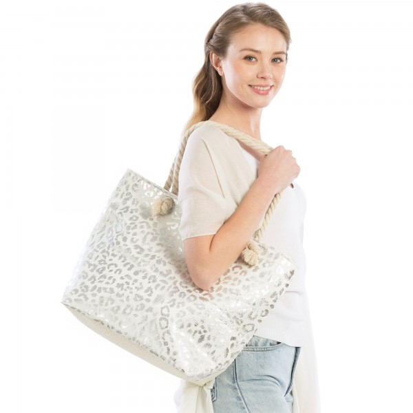 "Metallic Leopard Print Canvas Tote Bag.  - Zipper Closure - Open Lined Inside - 1 Open Inside Pocket - Rope Handles - Approximately 19"" x 14""  - 90% Paper, 10% Polyester"
