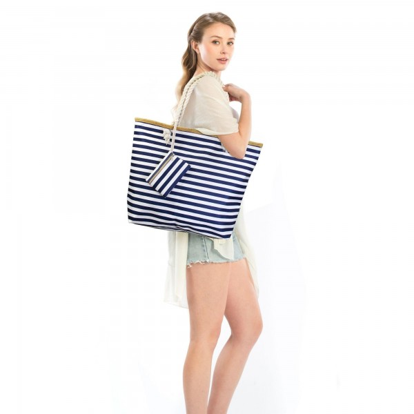 "Striped Tote Bag Featuring Matching Coin/Card Pouch.  - Zipper Closure - Open Lined Inside  - 1 Inside Open Pocket - 12"" Rope Handles - Detachable Coin/Card Pouch - Approximately 21"" x 16""  - 35% Polyester / 65% Cotton"