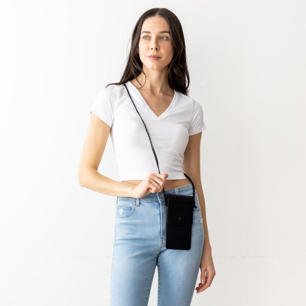 "Faux Leather Cross Body Bag Featuring Inside Pocket, Snap Closure, And Clear Back Pocket.   - Clear Back Pocket Makes Hands Free Phone Use a Breeze  - Approximately 7"" x 5"" in Size - Strap Approximately 25"" in Length"
