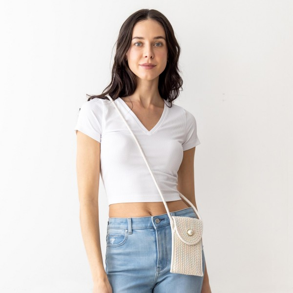 """Woven Cross Body Bag Featuring a Faux Pearl Accent.   - Snap Closure - Strap is Approximately 23"""" Long  - Approximately 7"""" x 5""""   * Regularly priced items."""