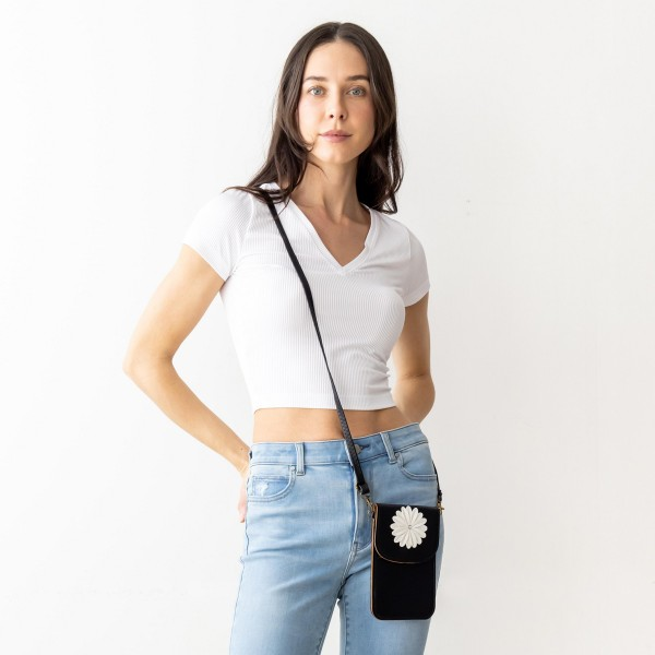 """Faux Leather Cross Body Bag Featuring Inside Pocket, Snap Closure, And Clear Back Pocket.   - Clear Back Pocket Makes Hands Free Phone Use a Breeze  - Approximately 7"""" x 5"""" in Size - Strap Approximately 25"""" in Length"""