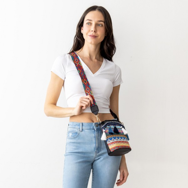 """Tribal Bucket Bug Featuring Wide Strap and Tassel Accents.   - Zipper Closure - 100% PU - Approximately 8"""" x 6"""""""
