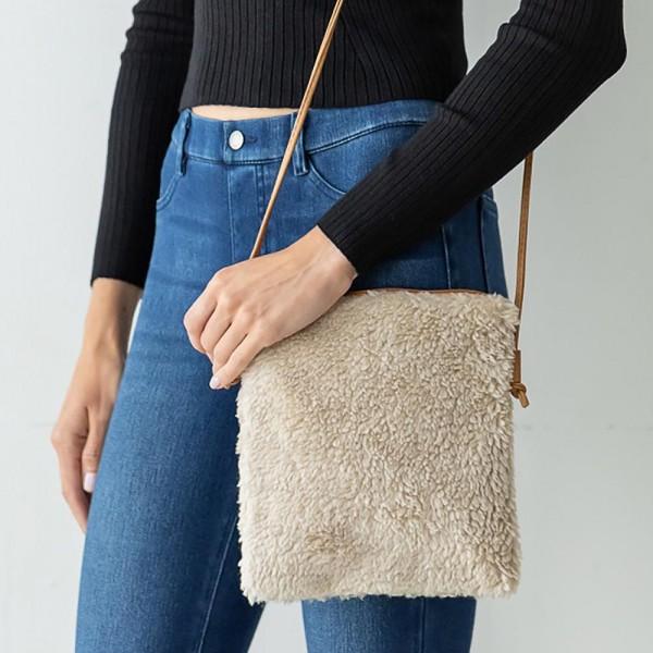"Faux Fur Cross Body Bag Featuring Leather Strap and Zipper Closure.  - 100% Polyester - Zipper Closure - Leather Strap Approximately 22"" in Length - Bag Approximately 8"" W x 9"" L"