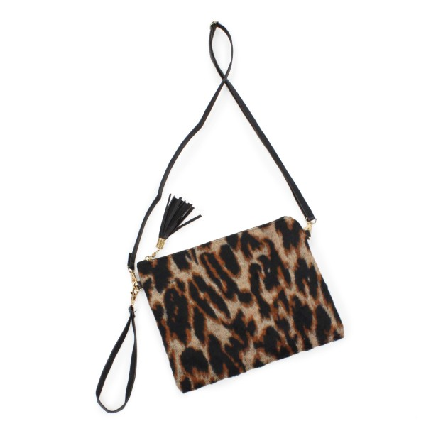 """Printed convertible handbag featuring faux leather tassel zipper pull   -Removable faux leather crossbody strap 26""""- 52"""" L -Removable faux leather wristlet strap -Approximately 11""""W x 9""""H -100% Polyester"""