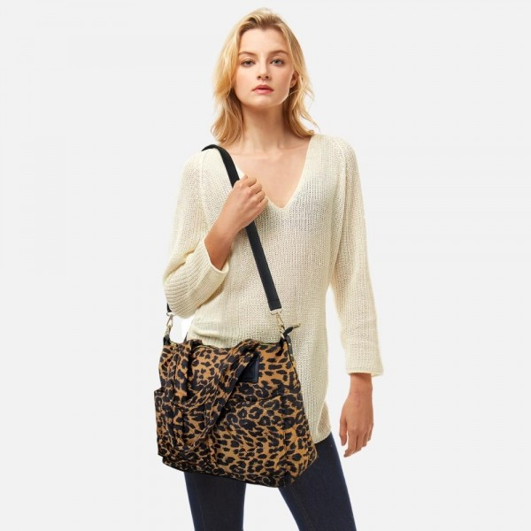 """Leopard print quilted tote bag featuring top handles and removable cross body strap.  -Full zipper closure -3 internal pockets  -3 external pockets -Approximately 15.5"""" W x 11"""" H x 5"""" D"""