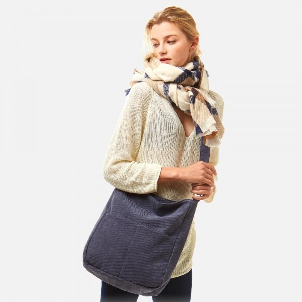 """Corduroy Cross Body Handbag -Approximately 16""""W x 15""""L  -Adjustable strap 12.5""""-24"""" L -Magnetic closure -2 external pockets -3 internal pockets with one zippered -100% Polyester"""