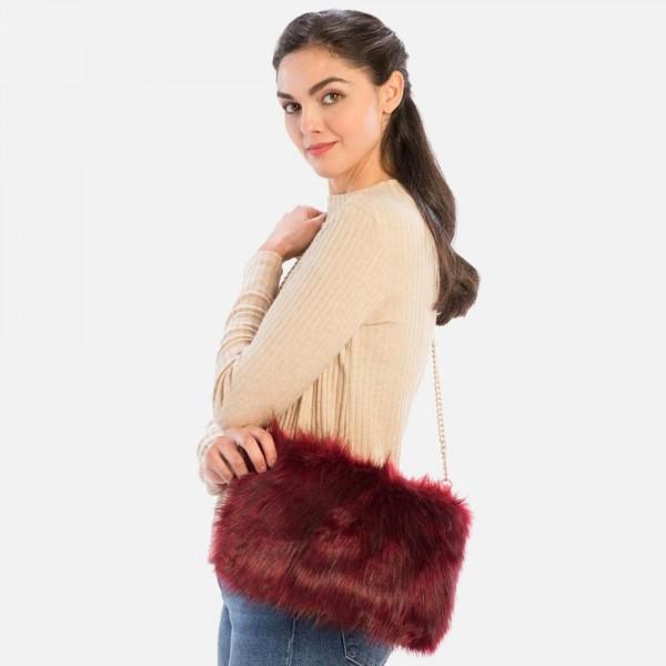 "Faux Fur Tote Bag   -Detachable chain handles  -Zipper closure  -100% Polyester  -Approximately 13"" x 10"""