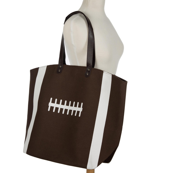 "Football tote bag perfect for tailgating and monogramming. This bag features a snap closure, lined interior and interior pockets. 16"" x 19"" in size with a 10"" handle drop. 80% cotton and 20% polyester."