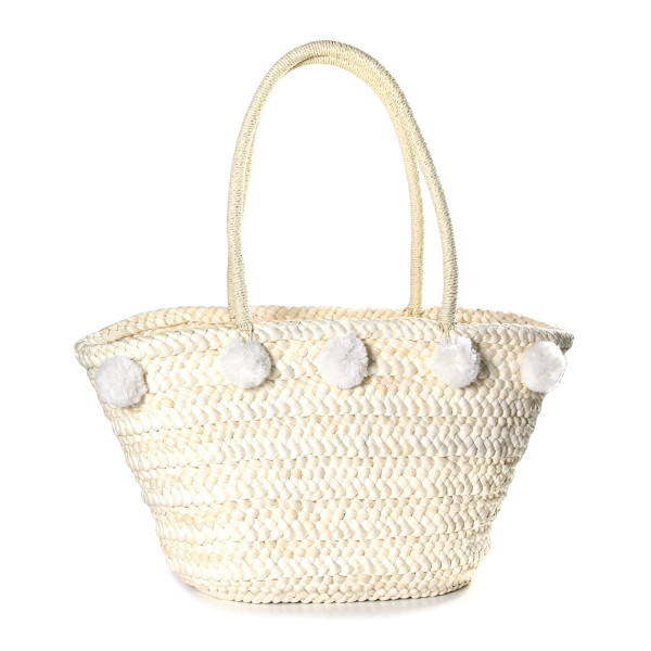 """Woven straw tote bag with pom pom accents. Measures 11"""" in width at the bottom, 17"""" at the top, 11"""" in height and a 10"""" shoulder drop."""