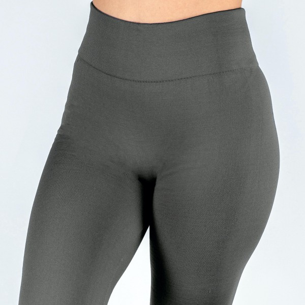 "Women's New Mix Brand Solid Color Seamless Fleece Lined Leggings.  - Fleece Lined - 2"" Elastic Waistband - Full-Length - One size fits most 0-14 - Inseam Approximately 26"" L - 92% Nylon / 8% Spandex"