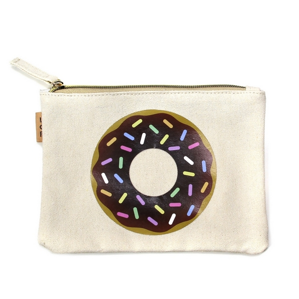 "Sprinkled Donut Canvas Travel Pouch.  - Open lined inside - Zipper closure - Approximately 7"" W x 6"" T  - 100% Cotton"
