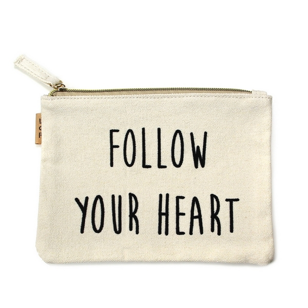 """Follow Your Heart"" Canvas Travel Pouch.  - Open lined inside - Zipper closure - Approximately 7"" W x 6"" T  - 100% Cotton"