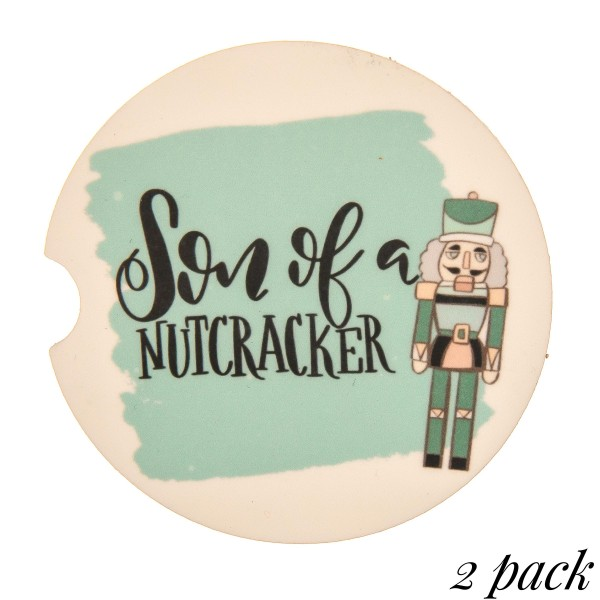 """Son of a Nutcracker"" illustration printed car coaster set.  - Pack Breakdown: 2pcs / pack - Approximately 2"" in diameter - Finger slot for easy removal - Condensation absorbing cork"
