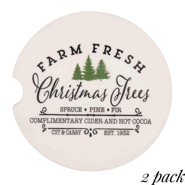 """Farm fresh Christmas Trees"" printed car coaster set.  - Pack Breakdown: 2pcs / pack - Approximately 2"" in diameter - Finger slot for easy removal - Condensation absorbing cork"