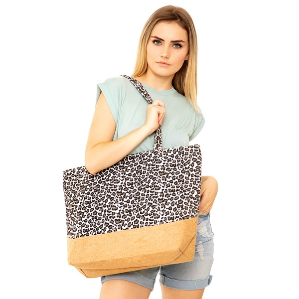 "Leopard Print Canvas Tote Bag.  - Zipper closure - One inside open pocket - Approximately 20"" W x 14"" T  - 12"" Strap - 100% Polyester"
