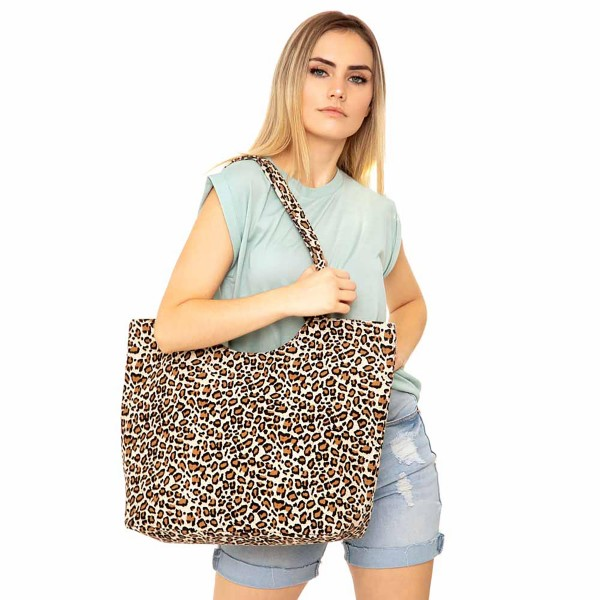 "Leopard Print Canvas Tote Bag.  - Zipper closure - One inside open pocket - Approximately 19.5"" W x 14"" T  - Strap length 12"" - 65% Cotton, 35% Polyester"