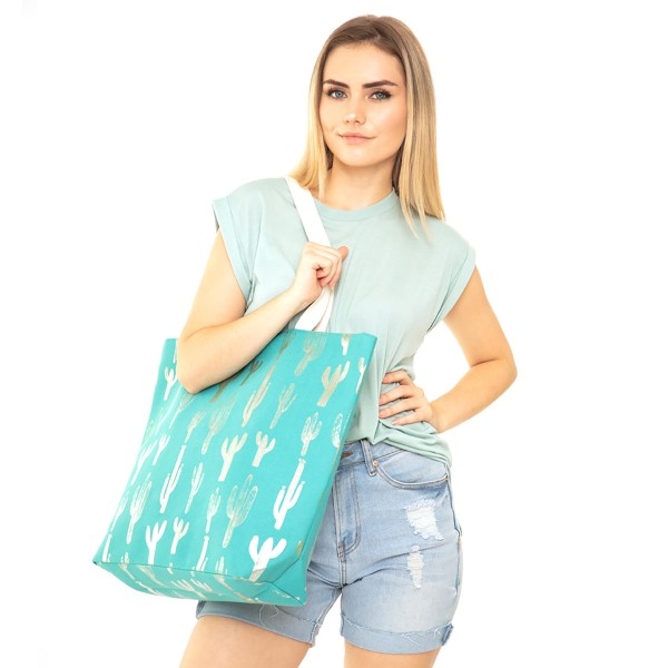 "Metallic Cactus Print Canvas Tote Bag.  - Button closure - One inside open pocket - Handles 12"" L - Approximately 20.5"" W x 16"" T  - 60% Cotton, 40% Polyester"