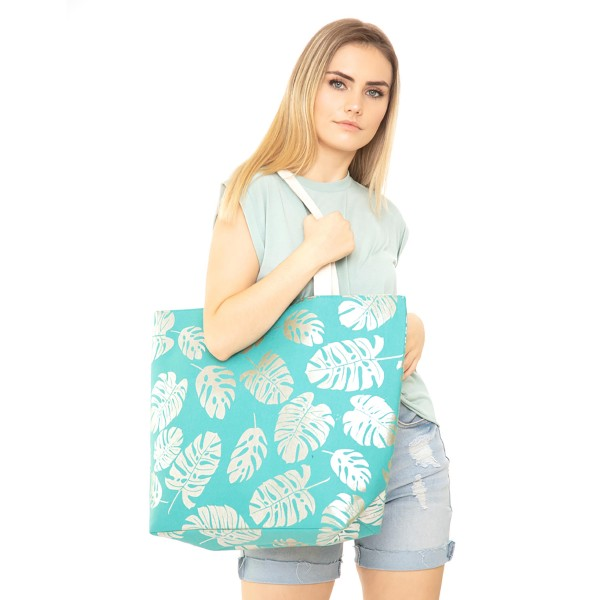 "Metallic palm leaf canvas beach bag with rope strap details.  - Button closure - One inside open pocket - Approximately 20.5"" W x 16"" T  - Strap length 12"" - 60% Cotton, 40% Polyester"