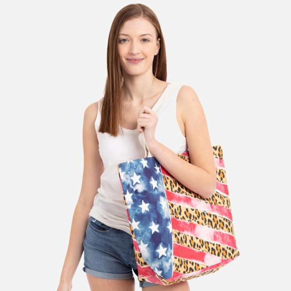 "Leopard print American flag beach bag.  - Button closure - One inside open pocket - Approximately 20.5"" W x 16"" T  - Strap length 12"" - 60% Cotton, 40% Polyester"