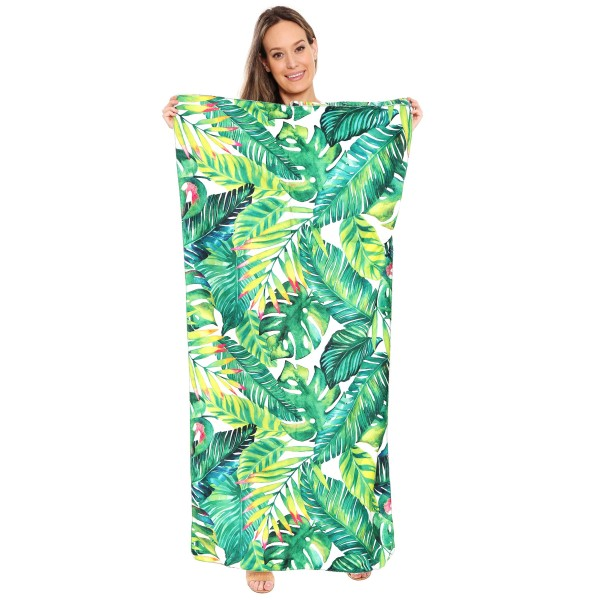 "Tropical Palm Leaf Beach Towel Drawstring Bag All in One.  - Unfold your bag to use the soft beach towel - Conveniently folds back into a drawstring bag - Towel approximately 27"" W x 59"" L - 70% Cotton / 30% Polyester"
