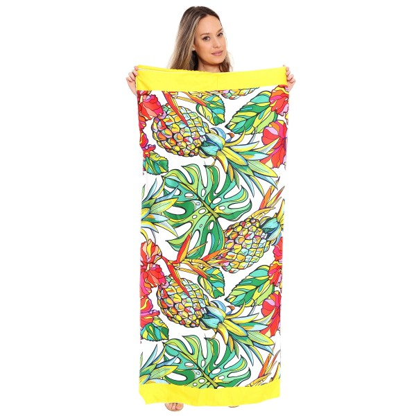 "Multicolor Tropical Beach Towel Drawstring Bag All in One.  - Unfold your bag to use the soft beach towel - Conveniently folds back into a drawstring bag - Towel approximately 27"" W x 59"" L - 70% Cotton / 30% Polyester"