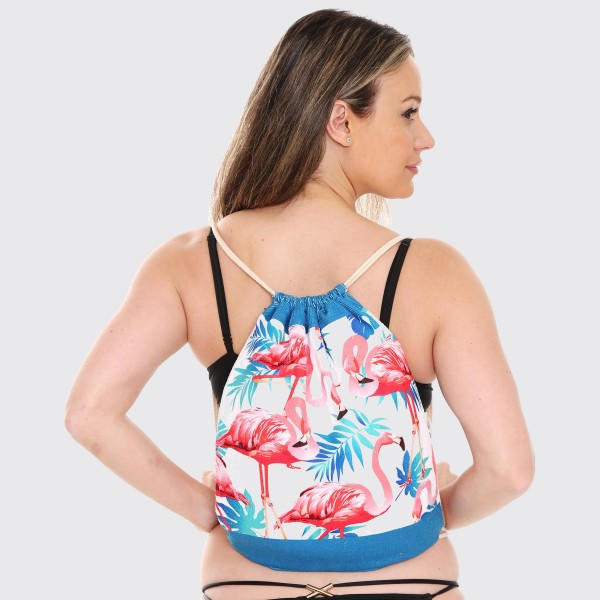 """Pink Flamingo Beach Towel Drawstring Bag All in One.  - Unfold your bag to use the soft beach towel - Conveniently folds back into a drawstring bag - Towel approximately 27"""" W x 59"""" L - 70% Cotton / 30% Polyester"""