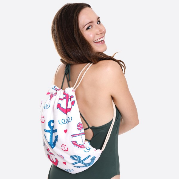 "Pink & Blue Anchor Print Beach Towel Drawstring Bag All in One.  - Unfold your bag to use the soft beach towel - Conveniently folds back into a drawstring bag - Towel approximately 27"" W x 59"" L - 70% Cotton / 30% Polyester"