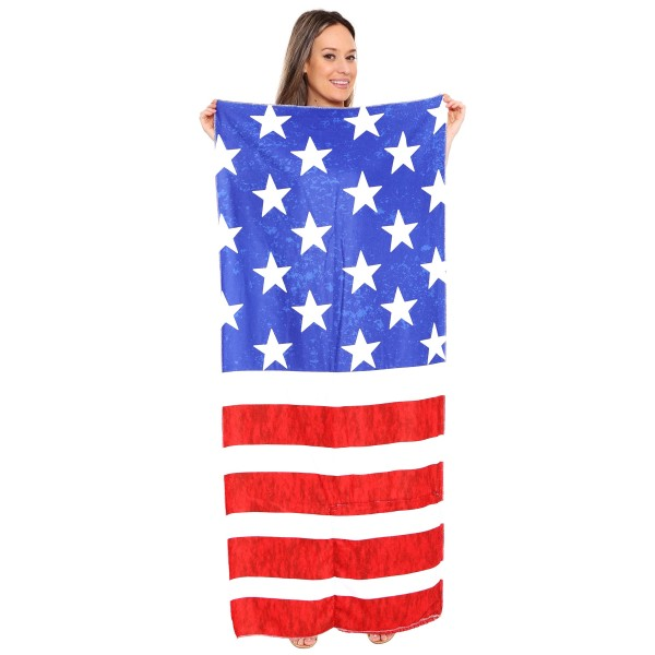"Stars and Stripes Patriotic Beach Towel Drawstring Bag All in One.  - Unfold your bag to use the soft beach towel - Conveniently folds back into a drawstring bag - Towel approximately 27"" W x 59"" L - 70% Cotton / 30% Polyester"