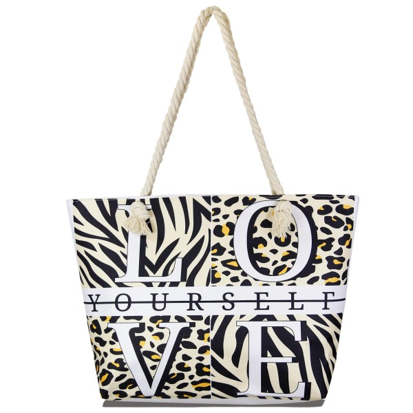 """Love Yourself"" Animal Print Tote Bag.  - Open inside pocket - Zipper closure - Rope handles - Approximately 22"" W x 14"" T - Handles 12"" L - 65% Polyester, 35% Cotton"