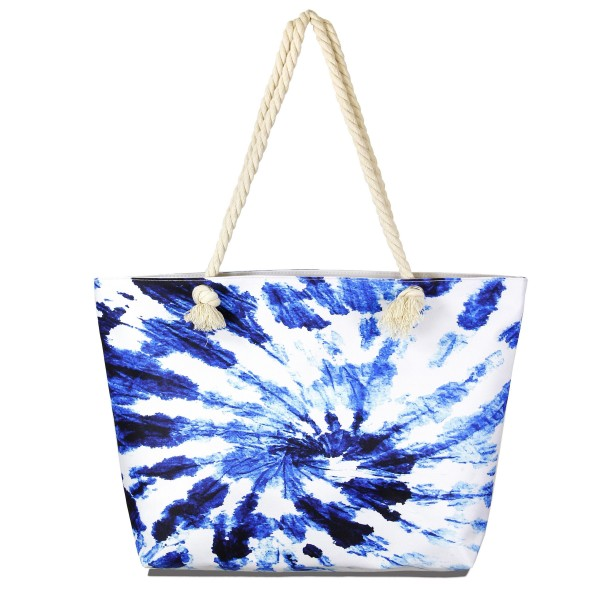 "Blue Tie-Dye Tote Bag Featuring Rope Handles.  - Open inside pocket  - Zipper closure - Rope handles - Approximately 22"" W x 14"" T - Handles 12"" L - 65% Polyester, 35% Cotton"