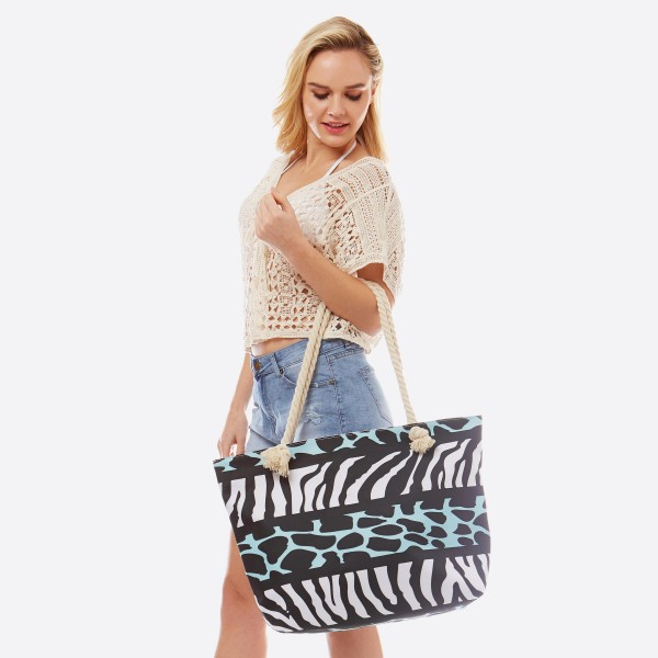 "Animal Print Tote Bag.  - Open inside pocket  - Zipper closure - Rope handles - Approximately 22"" W x 14"" T - Handles 12"" L - 65% Polyester, 35% Cotton"