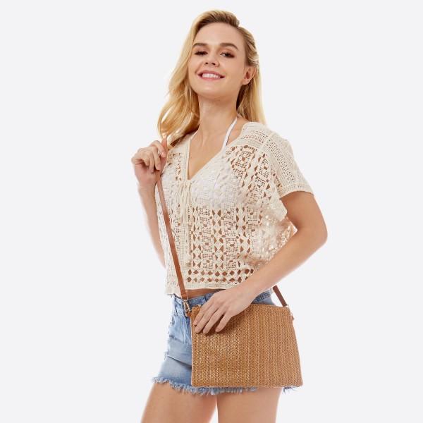 "Women's raffia woven handbag with detachable wristlet.  - One inside zipper pocket - Zipper closure - Detachable wristlet 8"" L - Adjustable strap 54"" L - Approximately 11"" W x 7"" T - 90% Polyester, 10% PU"