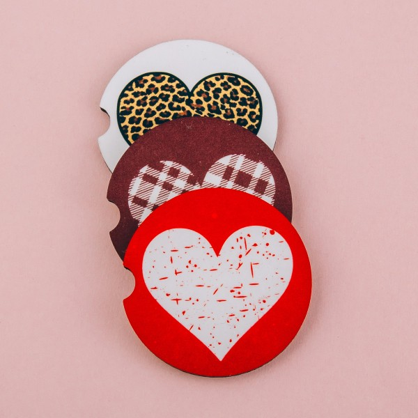 """Plaid heart printed car coaster set.  - Pack Breakdown: 2pcs / pack - Approximately 2"""" in diameter - Finger slot for easy removal - Condensation absorbing cork"""