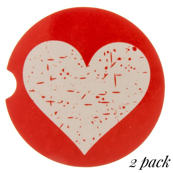 """Red distressed heart printed car coaster set.  - Pack Breakdown: 2pcs / pack - Approximately 2"""" in diameter - Finger slot for easy removal - Condensation absorbing cork"""
