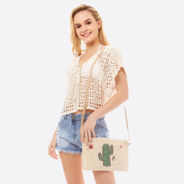 """Cactus print straw crossbody bag.  - Open lined inside - 1 inside zipper pocket - Zipper closure - Adjustable faux leather handle - Approximately 11"""" W x 8"""" T - 90% Polyester, 10% PU"""